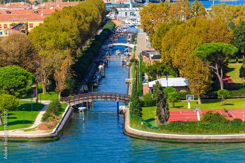 Fotografie, Obraz  Tree Lined Canal in Venice