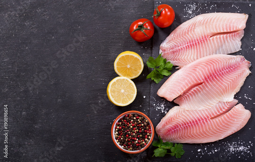 Tablou Canvas fresh fish fillet with ingredients for cooking