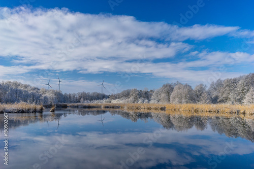 Winter lake, snow and blue sky