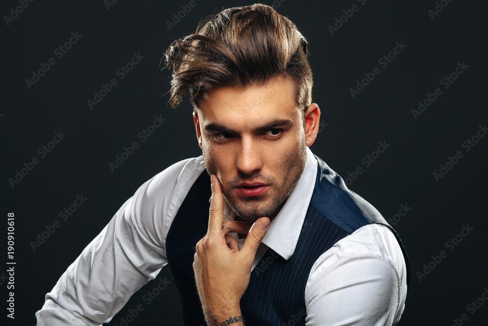 Fototapeta Portrait od handsome man in studio on dark background