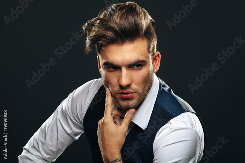 Tuinposter Kapsalon Portrait od handsome man in studio on dark background