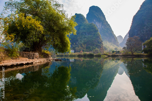 Poster Reflexion Beautiful landscape of karst mountains reflected in water, Yulong river in Yangshuo South China.