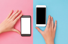 Female Hands Hold Two Phones B...