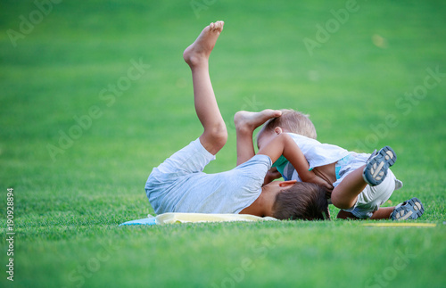Photo  Two boys fighting outdoors