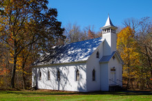 White Country Church In The Autumn Woods