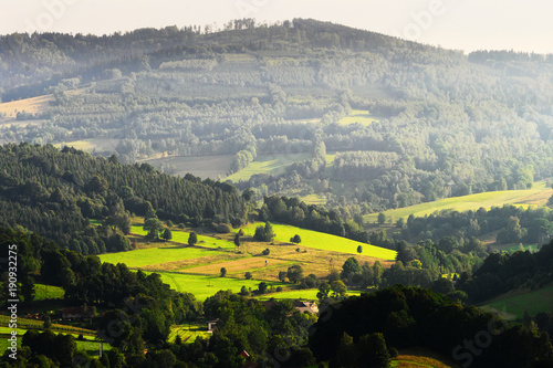 Foto auf Gartenposter Hugel Hills and sunny valley in the Walbrzyskie Mountains (Gory Walbrzyskie) or Waldenburg Mountains. Vast panorama of picturesque countryside landscape in Sudetes, Poland. Aerial view.