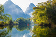 Amazing natural landscape. Beautiful karst mountains reflected in the water of Yulong river, in Yangshuo, Guangxi province, China.