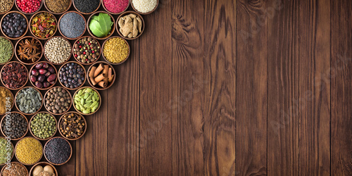 Recess Fitting Spices large set of spices on a wooden table, top view