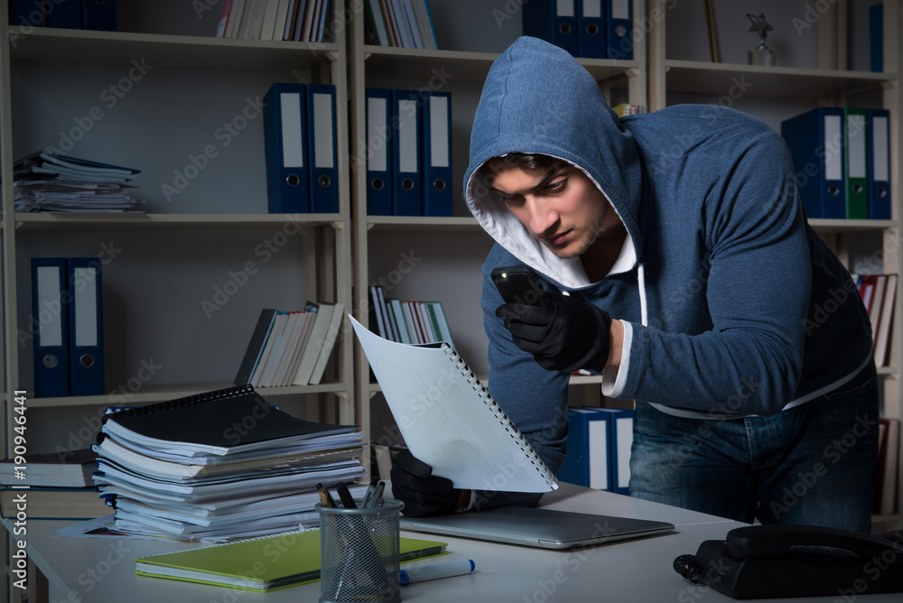 Fototapeta Young man in industrial espionage concept
