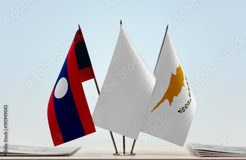 Flags of Laos and Cyprus with a white flag in the middle