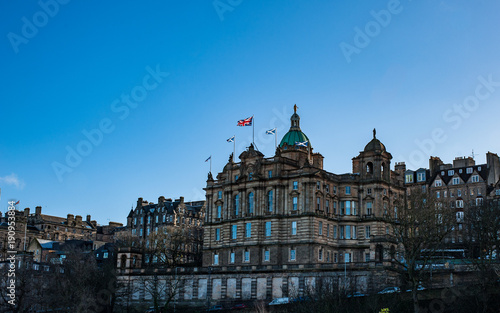 Photo Scottish Saltire and British Union Jack flags on a top of a building of Lloyds B