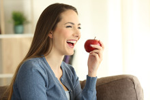 Happy Woman Eating An Apple Lo...
