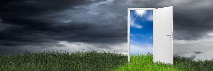 Open door on green wide panorama green grass meadow in front of blue sky / Türe offen wiese grün panorama