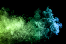 .Colorful Blue And  Green Smoke Clouds On Dark Background.Background Of Smoke Vape.