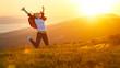 Leinwandbild Motiv Happy woman jumping and enjoying life  at sunset in mountains