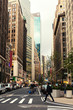 Broadway street in Manhattan's midtown by early evening, New York City, United States. Toned image