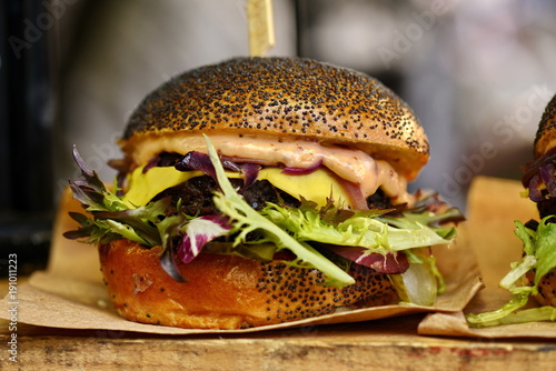vegan burger in the street market © Iliya Mitskavets