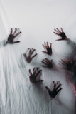 blurry scary silhouettes of human hands touching frosted glass - 191017240
