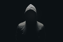 Faceless Man In Hoodie Standin...