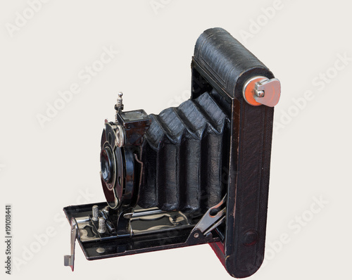 Fotomural old bellows camera on a simple white background