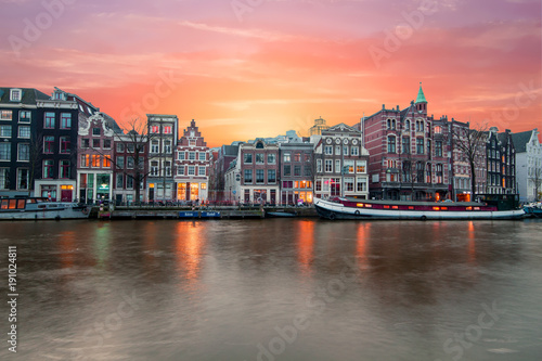 Photo  Amsterdam at the river Amstel at sunset in the Netherlands