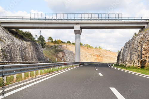 Scenic view on overpass and highway road leading through in Croatia, Europe / Beautiful natural environment, sky and clouds in background / Transport and traffic infrastructure / Signs and signaling Wallpaper Mural