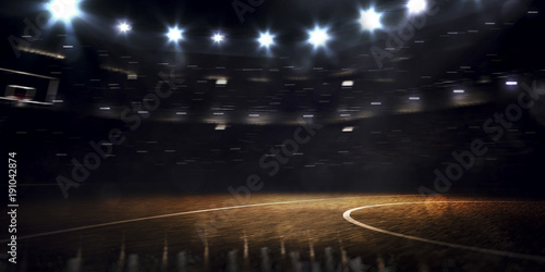 Fotografering Grand basketball arena in the dark spot light
