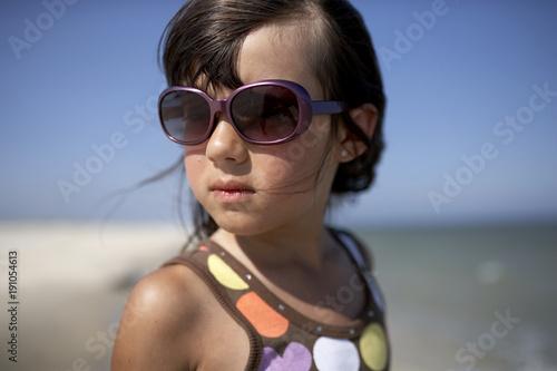 Girl with sunglasses on beach