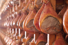In A Ham Factory There Are Hams Hung To Season After Having Undergone The Various Processes According To The Ancient Italian Tradition. Concept Of: Tradition, Italy, Food.