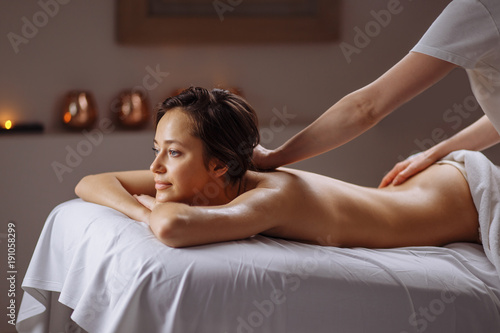 Fototapety, obrazy: Beautiful woman receiving a relaxing back massage at spa.