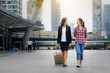 Joyful mother and daughter walk together after mother back form travel
