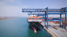 View Of An Industrial Port Where Freight Loads Are Carried For National And International Shipping By Sea Or Ocean On Cargo Ships. Concept Of: Transportation, Ships, Trade.