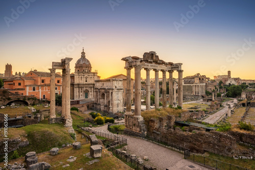 Poster Rome Ruins of Roman's forum at sunrise, ancient government buildings , temple and shrine of Roman empire