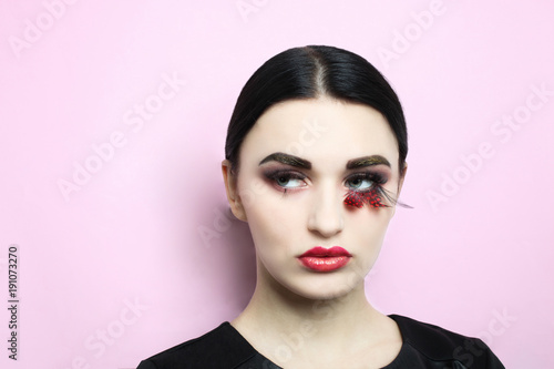 Fototapety, obrazy: Beautiful girl, brunette with beautiful make-up in and lengthened eyelashes on a pink background.