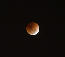 Super Full Blood Moon With Total Lunar Eclipse On Dark Sky