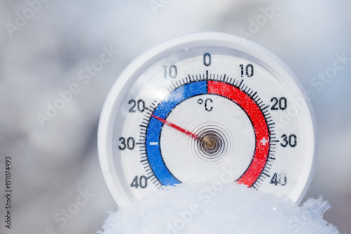 Fototapeta Outdoor thermometer in snow shows minus 21 Celsius degree cold winter weather co