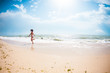 The girl runs along the beach.