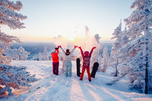 Happy Team Of Snowboarders Having Fun Tossing Snow And Fun.