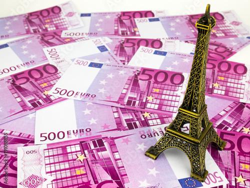 Fotografiet  Five hundred 500 Euro bills banknotes with Eiffel tower replica, European curren