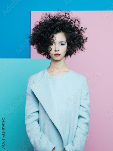 Poster womenART Fashion portrait of beautiful asian woman in sky-blue coat