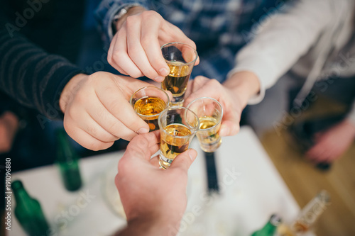 Foto op Plexiglas Alcohol Group of friends cheering with shots of alcohol