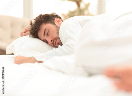 closeup.the tired men sleep soundly on the bed Poster