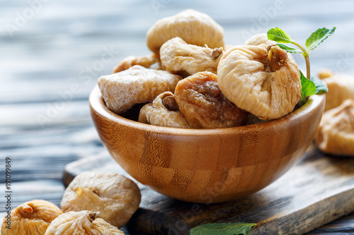Wooden bowl with dried figs.