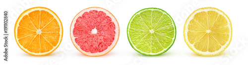Photo Stands Fruits Isolated citrus slices. Fresh fruits cut in half (orange, pink grapefruit, lime, lemon) in a row isolated on white background with clipping path