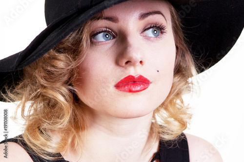 Photo  Pretty blond girl model like Marilyn Monroe in black dress with red lips on white background