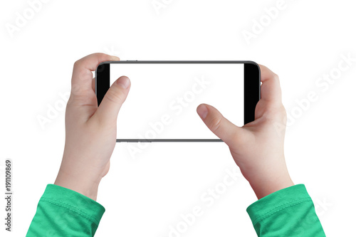 Boy hands holding smartphone in horizontal position with isolated white screen for mockup. Surfing online, playing games, watching video online...