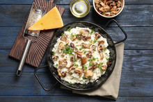 Dish With Risotto And Mushrooms On Table