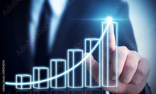 Business development to success and growing annual revenue growth concept, Businessman pointing arrow graph corporate future growth plan