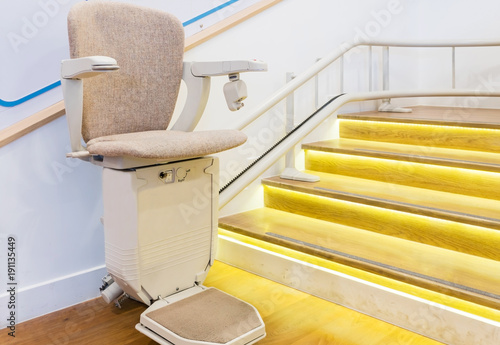 Fototapeta Automatic stair lift on staircase for elderly people and disabled persons obraz
