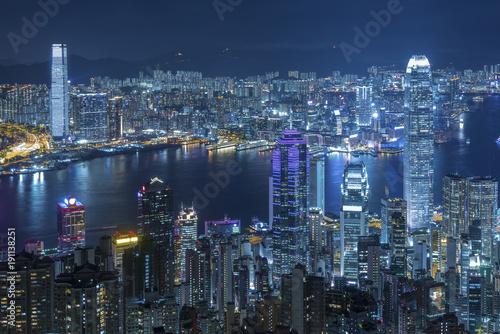 Aerial view of Victoria Harbor of Hong Kong city at night